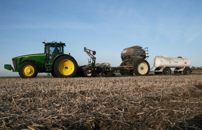 Slide_6_Ton_Montag_with_Lift_Assist_behind_12_row_Remlinger_Strip_Till_bar